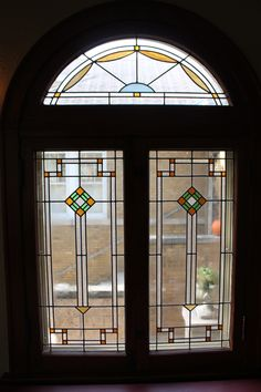 Recreated Leaded glass in a Chicago Bungalow. The original panels were missing so the owner learned how to do stained glass and made these new panels in a period style. HCBA - Driehaus Gallery - Brabeck