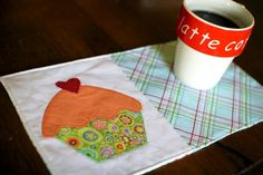 Cupcake Mug Rug Pattern - Learning how to applique adorable designs onto your smaller quilting projects like mug rugs, placemats, baby quilts, and more can transform your quilting pieces into unique, cute gifts.