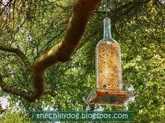 10 Ways to Reuse Wine Bottles corks. A wine-bottle bird feeder. Photo: Ellen Thomas/The Chilly Dog Reuse Wine Bottles, Large Wine Bottle, Wine Bottle Corks, Old Bottles, Wine Bottle Crafts, Altered Bottles, Antique Bottles, Vintage Bottles, Liquor Bottles