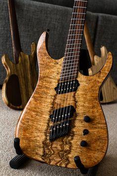 "Ormsby ""hypemachine"" with cocobolo fretboard, tasmanian blackwood body, spalt/burl maple top — http://www.sevenstring.org/forum/extended-range-guitars/259388-ngd-ormsby-hypemachine-spalty-burly-seriously-pic-heavy.html"