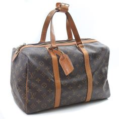 This is a fabulous and 100% authentic Louis Vuitton Monogram Sac Souple 35 Travel Bag. It is a gorgeous style and very rare nowadays. Features: Spacious interior, same size as LV speedy 35 but has a more structured shape Zip top closure Strap keeper Luggage tag Made in France, Date code: TH8911 ( on the reverse  ...Read the Rest...