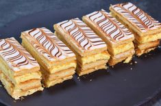 """Traditional recipe for Mille feuilles. Translating literally as """"a thousand leaves"""", this world-famous French dessert consists of three components: puff pastry, pastry cream or whipped cream, and a glaze or a fondant French Crepes, French Pastries, Puff Pastry Recipes, Crepe Recipes, Cinnamon Tea Cake, Delicious Desserts, Dessert Recipes, French Desserts, Tea Cakes"""
