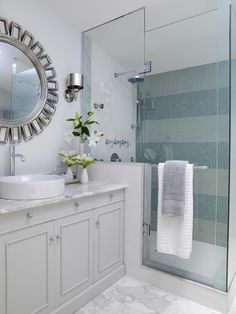 Glass shower enclosures give the illusion of space in a small bathroom by allowing you to see from one end of the room to the other. Design by Sarah Richardson