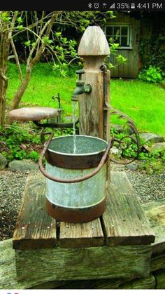 Fontaine extrieure de jardin pierre bassin pots fleurs charming rustic garden fountain from found objects instead of a fountain this could serve as the hub where i connect hose to all my soaker hoses solutioingenieria Images
