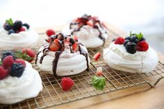 A gorgeous, yet simple-to-make Pavlova with puffed shells, sweet cream, and fresh fruit. Gourmet Recipes, Dessert Recipes, Trifle Desserts, Gourmet Foods, Copycat Recipes, Mini Pavlova, Dessert From Scratch, Pavlova Recipe, Vegetarian Chocolate