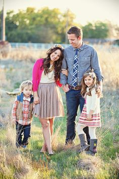 cute family pose. Love the bow tie and the vest on the little boy!