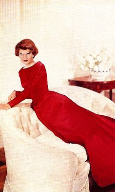 """Jackie Kennedy. She was modeling this gown for """"The Ladies' Home Journal"""" in 1957. The red color of the gown on her is stunning...she would soon be First Lady but at that time, she could have easily been a movie star!"""