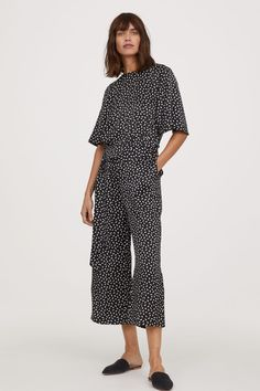 Black/patterned. PREMIUM QUALITY. Jumpsuit in silk satin with a printed pattern. Opening at back of neck with button, short, wide sleeves, and seam at waist