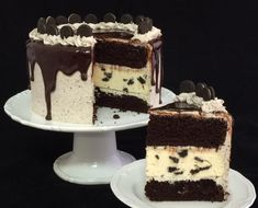 The Ultimate Oreo Dessert! Two thick layers of moist chocolate cake surrounding a fluffy Oreo Cheesecake, covered with Oreo Cream Cheese Icing, topped with chocolate ganache and baby Oreos. supersweettooth.com