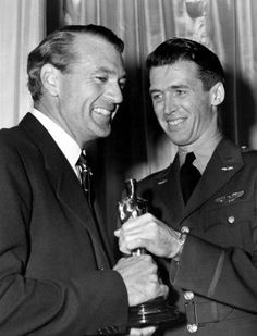 "14th Academy Awards® (1942) ~ James Stewart ~ (1908 – 1997) presents Gary Cooper ~ (1901 – 1961) with the Best Actor Oscar® for his performance in ""Sergeant York"" (1941)  (Won 2 Oscars. Another 11 wins & 6 nominations)"