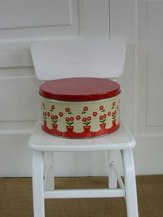 Red and white vintage tin.