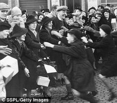 Evacuated children at a reunion with their parents, December 1939