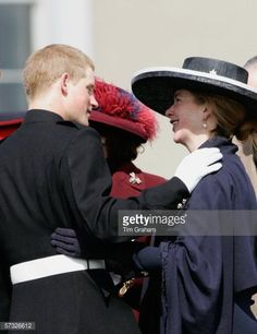 Prince Harry is greeted by Tiggy Legge-Bourke at the Sovereign's Parade at Sandhurst Military Academy where he passed-out as commissioned officer Second Lieutenant Harry Wales of the Blues and Royals on April 12, 2006 in Surrey, England