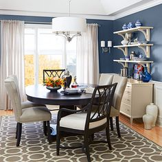 Create a delicious dining room on a dime. Set your table and chairs under an eye-catching chandelier and frame the windows with sleek coordinating sconces. Replace dated window treatments and paint the tired trim.
