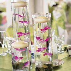Submerged purple orchid centerpieces from Steamboat's Tall Tulips topped the guest tables.