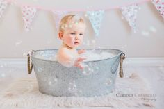 Cake smash & bubble bath, Cornwall. First birthday baby portrait photography in Truro, Cornwall. Cake smash followed by a bubble bath - too cute!!! Taken in the studio using natural window light and bubbles... lots of bubbles.