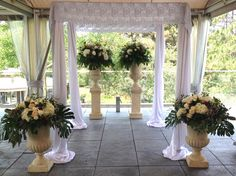 All white satin with a touch of lace by www.chuppah.ca