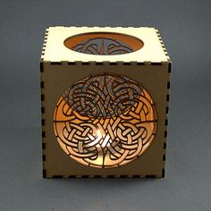 Candle Lantern, Celtic Knot Pattern For Tee Light . Laser cut from 3mm mdf.  This is a closed path quaternary knot, generally considered to depict eternity
