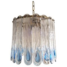 Italian Ice Glass Chandelier by Mazzega | From a unique collection of antique and modern chandeliers and pendants  at https://www.1stdibs.com/furniture/lighting/chandeliers-pendant-lights/