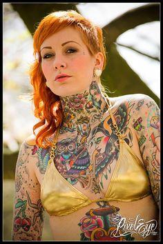 Old school tattoos, some seriously colourful ink, loving the hair as well x