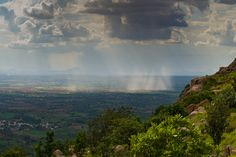 https://flic.kr/p/xoKNWa | View from Makalidurga Hill Fort | View from Makalidurga, a hill fort which is 60 kms north of Bangalore. Captured this landscape image of the cloud formation and the rain, in the nearby Doddaballapura village. www.ravindrajoisa.com
