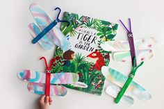 "Dragonfly Craft inspired by ""There's A Tiger In The Garden"" · Book Nerd Mommy Stem Classes, Dragon Fly Craft, Pond Life, Class Projects, Garden Crafts, Baby Crafts, Book Nerd, New Books, Childrens Books"