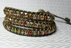 Gold and gold/green/burgundy AB Czech glass by flordenochestudio