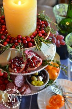 VERTICAL CHEESE BOARD - Loaded with great cheeses, meats, veggies, fruit, olives and nuts. Guest love it and there is something for everyone! And the best part is… I don't have to cook anything (love the candle, cranberries & rosemary on the top pedestal)