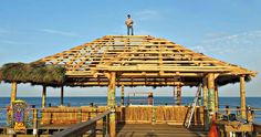 Big Kahuna completed the Rikki Tiki Tavern located at the end of the 800 foot Cocoa Beach Pier. Cocoa Beach's iconic landmark was purchased by Westgate Resorts in Since then… Diy Gazebo, Wooden Gazebo, Tiki Bar Stools, Tiki Hut, Wood Structure, Thatched Roof, Cocoa Beach, Breezeway, Palm