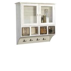Ib Laursen's white wall cupboard, with its rustic charm, offers a great variety of storage options. Whether well stowed behind the glass doors,. House Doctor, Bad Set, Behind The Glass, White Walls, China Cabinet, Home Projects, Bathroom Medicine Cabinet, Cupboard, Shabby Chic