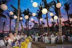 Destination wedding reception lighting. Kaileigh and Michael - Riu Palace Cabo San Lucas - Yellow wedding - Mexico - table decor