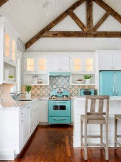 The Blue Appliances Accent The Whole Room Along With The Dark Wooden Beams On The