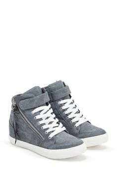 Wedge sneakers have never been more office appropriate than with Esteva by…