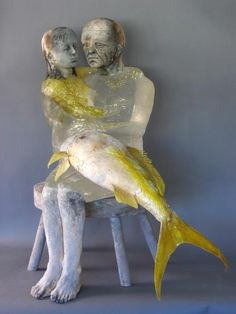 """""""I Fell into a Dream,"""" by Christina Bothwell. Material: cast glass, raku fired clay, oil paints, taxidermy, and wood (28 x 27 x 25 inches)"""