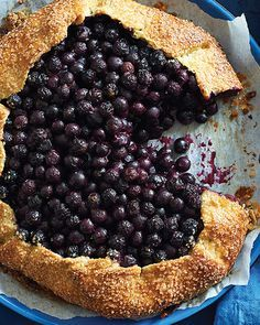This free-form tart showcases blueberries in all their sweet-tart juiciness. The toothy cornmeal crust is a surprisingly pleasing envelope for the warm, cooked fruit. #SweetPaul