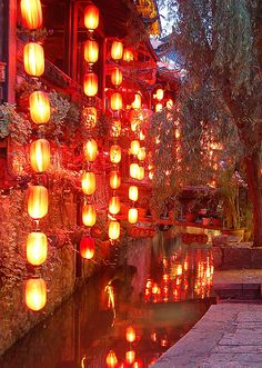 Lanterns of Lijiang. The old town of Lijiang has a ancient network of streams and canals. It is said that this network was built in such a way that water can reach every family and every street in the town.