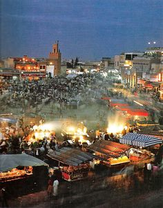Morning in the market in Marrakech, MOROCCO.  is the fire in the pic cooking breakfast?  busy area in the morn....