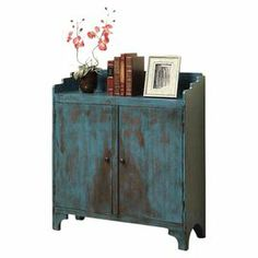 """2-door cabinet with a distressed teal finish.  Product: CabinetConstruction Material: MDF, poplar and birchColor: Distressed tealDimensions: 36"""" H x 32"""" W x 12"""" D"""
