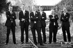 Groom and groomsmen outside The Canal on the tracks   HR Northwest Photography.