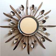 Spoons and fork as mirror frame