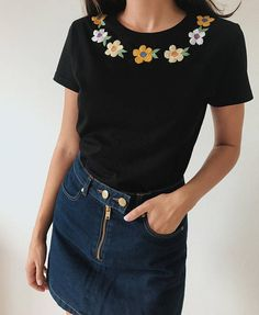 Cute chamomile hand emboroidered tee: This t-shirt has been embroidered by hand with flowers along the neckline. The cute flower embroidery adds some flair and a handcrafted touch to a plain tee. DETAILS: All embroidery is done by hand in 100% cotton thread. T-shirts are 100% cotton. The