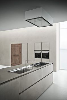 Zampieri - Line K #kitchen in cement resin and seasoned oak.