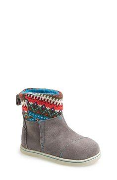 Free shipping and returns on TOMS 'Nepal - Tiny' Boot (Baby, Walker Toddler) at Nordstrom.com. A colorful knit pattern trims the shaft of a suede boot lined with cozy faux shearling. <br><br>Since Blake Mycoskie started TOMS in 2006, the company has given away 10 million shoes to children in need across the globe through sales of their now-iconic slip-on shoes and the 1 for 1 donation program.