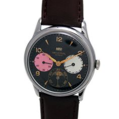 UNIVERSAL GENEVE SIDE SECOND HALF CALENDAR MOON PHASE AUTOMATIC WATCH  Feature : Side Second, Half Calendar, Moon Phase and Automatic Dial Features : Repainted Dial Dial Color : Black Markers : Golden Numeric and Arrow Figures Case Material : Top Crum Case with Stainless Steel Back Cover Condition : Used and Excellent as per its Age Sign : Signed on the Dial, Inside Back Cover and Movement Authentic : All Watches displayed are 100% Authentic and Original Crown : Pull Band Type : Leather