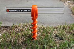 """Orange Screws are sold as the """"ultimate ground anchor."""" New this year, the multiuse stakes can hold hundreds of pounds when threaded deep into dirt."""