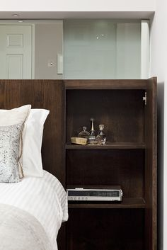 One of the timber panels opens to reveal a hidden bedside locker. All the joinery throughout was designed and detailed by Kingston Residential Interior Design, Home Interior Design, Interior Architecture, Bedside Lockers, Dresser As Nightstand, Joinery Details, Timber Panelling, Living Spaces, Home And Family