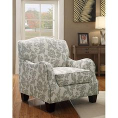 Add a pop of pattern to your living room or den with this lovely arm chair, showcasing damask-print linen upholstery and nailhead trim at jossandmain.com