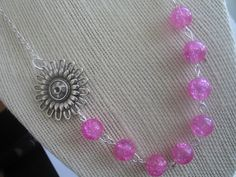 Pretty frosted pink bead sun/flower necklace, pink beaded necklace, sunflower charm beaded necklace, frosted pink necklace, sunburst flower by LeeliaDesigns on Etsy https://www.etsy.com/listing/126002452/pretty-frosted-pink-bead-sunflower