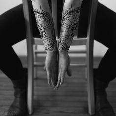 Roxx - 2Spirit Tattoo geometric blackwork matching forearm tattoo