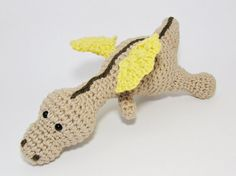 Amigurumi baby dragon crochet baby rattle soft toy organic cotton - beige, yellow and brown